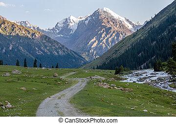Dirt road and rapid Djuku river. Kirgizstan - Dirt road and...