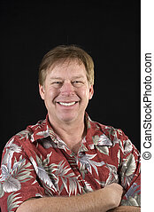 Happy smiling casual businessman in a floral Hawaiin style...