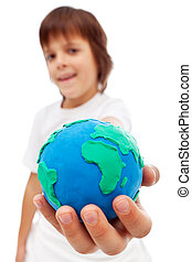 The world in my hand - young boy holding earth globe