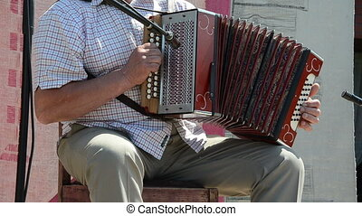 accordion buttons - man fingers a quick flit accordion...