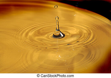 Water droplets and ripples on the surface