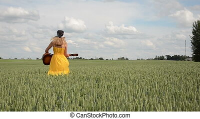 girl dress guitar field - pretty girl in dress and headscarf...