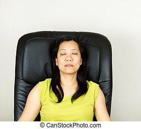 Mature Woman Relaxing in Massage Chair - Photo of mature...