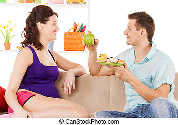 happy expecting parents at home - pregnancy and healthy...