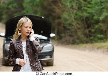woman at broken car with phone - Young woman at broken car...