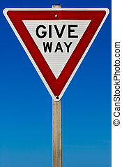 Give Way Sign - A traffic give way sign isolated on a blue...