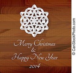 Vector white paper snowflake on a wooden background