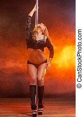 Portrait of a beautiful female dancer posing in black...