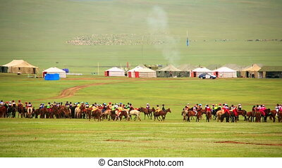 Paddock during Naadam Festival, Mongolia. Horses getting...