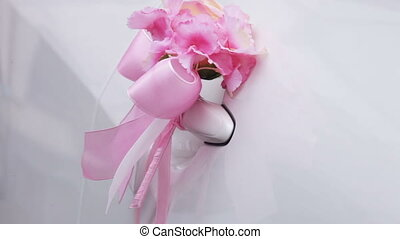 Wedding decorations on car - Pink decorative flower on a...
