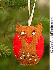Hand made owl, Christmas decoration, hanging on the fir
