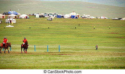 Men playing polo during Naadam Festival - Men playing polo...