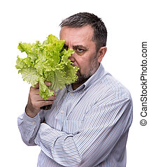 Organic food. Man holding lettuce isolated on white