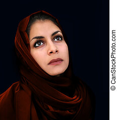 Arab girl in red scarf - A portrait of a young arab woman in...