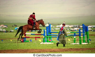 horse hurdle jumping during Naadam Festival - Competition of...