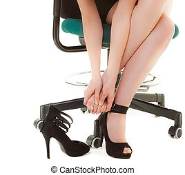 Work stoppage and foot pain. Business woman on chair taking...