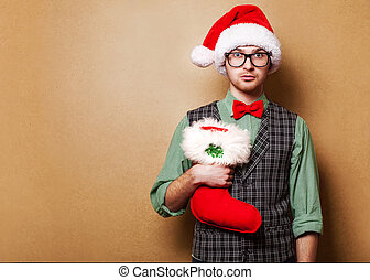 hipster in Santa Claus clothes with the bag of the presents...