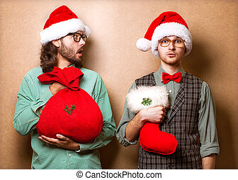 Two emotional Santa Claus dressed in clothes hipster with...