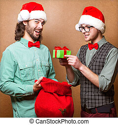 Hipster Santa Claus giving a gift