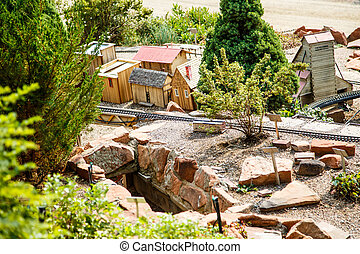 Model Railroad Track Past Toy Village - A model railroad...