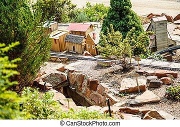 Model Railroad Track Past Toy Village - A model railroad...