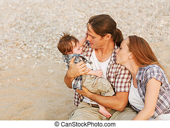 parents soothe a crying baby