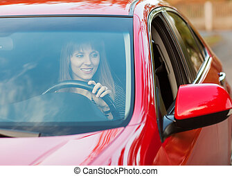girl traveling by car, looking in the side mirror