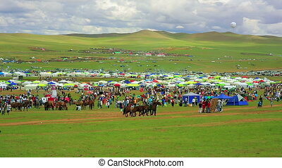 Colorful crowd at Naadam festival area, Ulaanbaatar,...