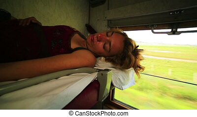 Trans Siberian train journey - Woman sleeping during trans...