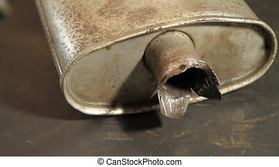Cutting metal from muffler - Cutting metal from muffler,...