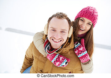 Cheerful dates - Portrait of happy young couple having fun...