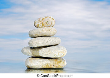 White Tower - Pyramid of white pebbles with a stone...