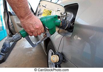 Man fuel his car - TEL AVIV,ISR - JULY 02:Man fuel his car...