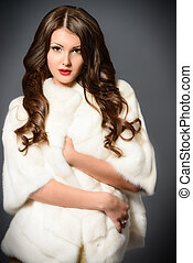 mink fur coat - Fashion shot of a beautiful young woman in...