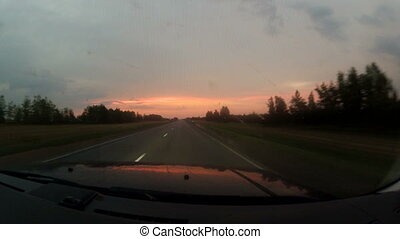 Travel on the highway at sunset