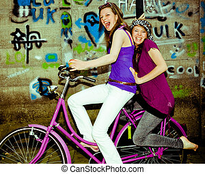 girls want to have fun - Real girls on a bicycle having fun....