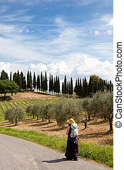 pilgrimage - pilgrim on her way in tuscany italy