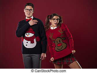 Crazy nerd couple in funny sweaters goofing around