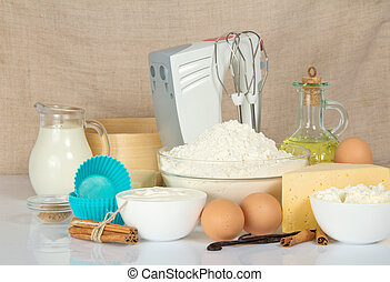 Mixer, sieve and products for dough - The cake pan, a mixer,...