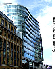 London Glass Buildings - A modern glass office building in...