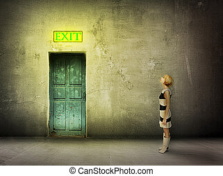 girl door room exit sign - young woman in black and white...