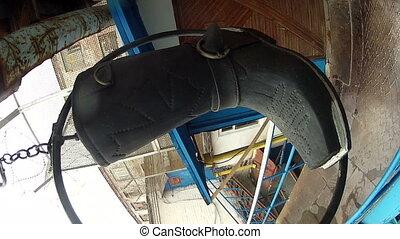 Suspended boots over the door Shoe repair