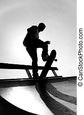 Skateboarder Silhouette - Silhouette of a young skateboarder...