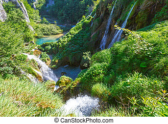 Summer waterfalls and grasses in Plitvice Lakes National...