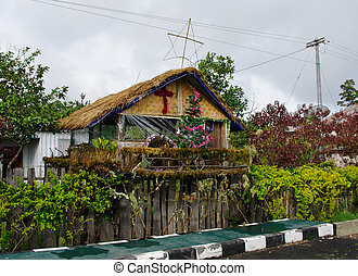 House decorated before Christmas, Papua Province, New Guinea...