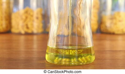 Olive Oil Jar Fill with Splashes - A glass jar fills up with...