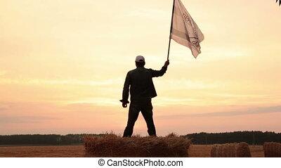 Man waving a flag
