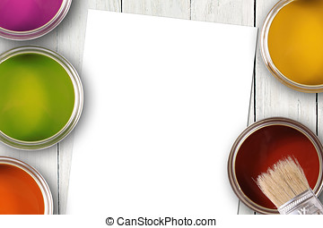 colorful paint cans and blank white paper sheet