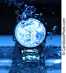 Watch Under Water Drops - Drops of water falling on a watch