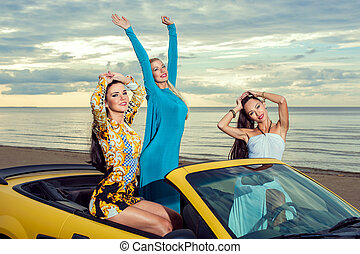 Three girls with sport car - Three girls with sport car on a...